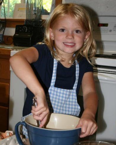 Girl learns to cook in home daycare program