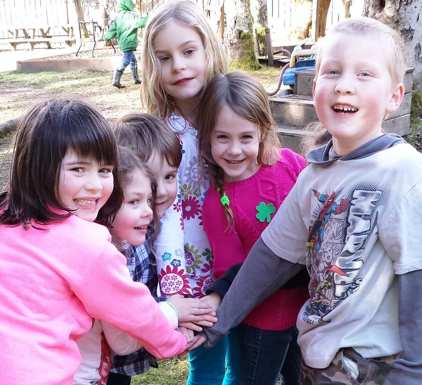 Children make lifelong friends in the child care program at Village Learning