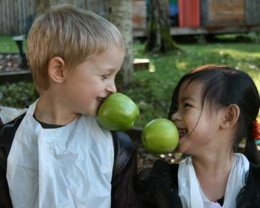 Children welcome Fall with apple bobbing in the childcare program