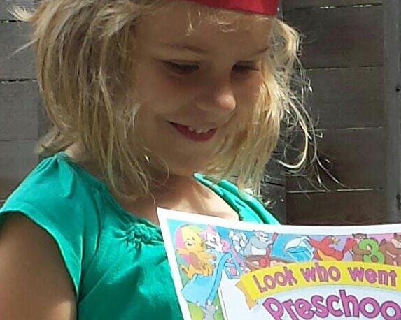 Proud girl graduates from Garden Gate Preschool