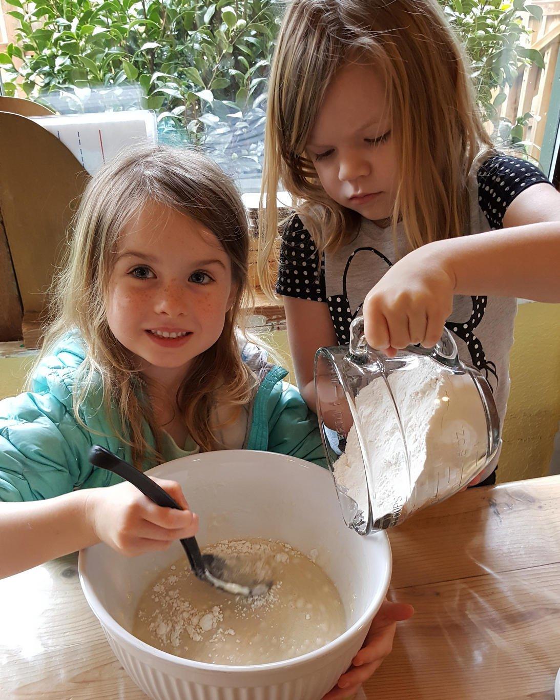 Girls learn to cook as part of preschool program