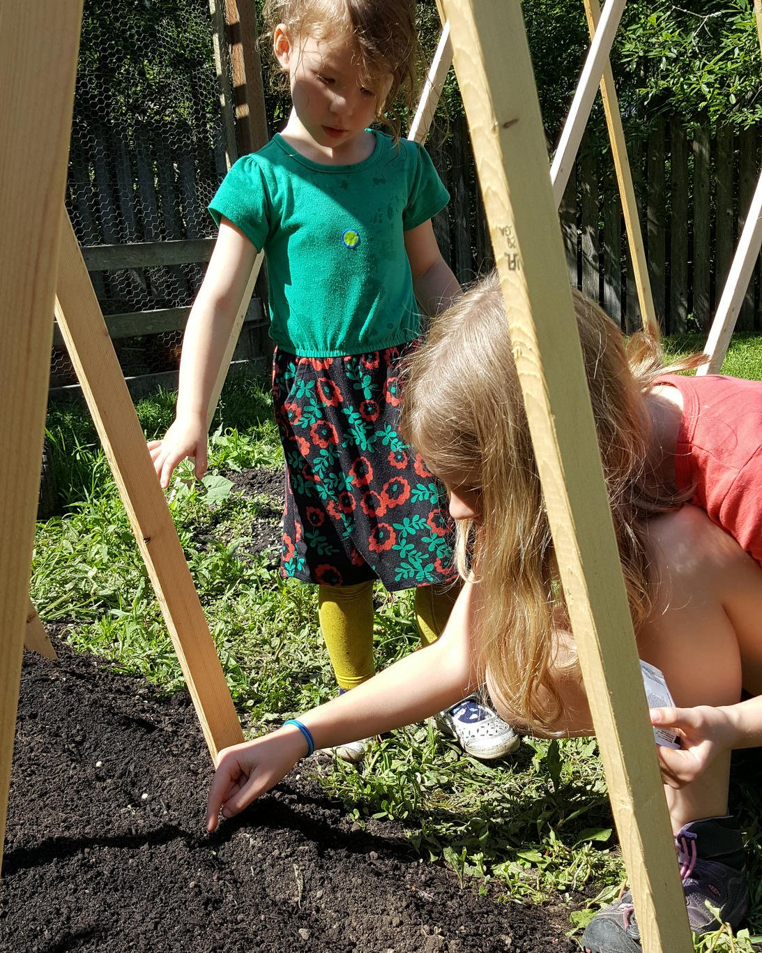 Planting the garden at Village Learning